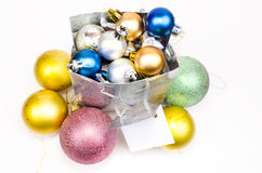 Gift bag and Christmas balls around Stock Image
