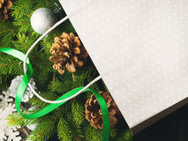 Gift bag with Christmas fir tree branches and ornaments Royalty Free Stock Photo