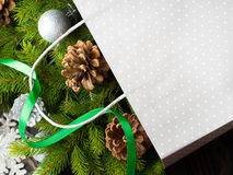 Gift bag with Christmas fir tree branches and ornaments Stock Photos