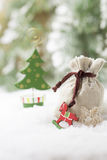 Gift bag. Christmas gift bag in the snow royalty free stock image