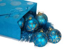 Gift bag full of christmas toys. Gift bag full of blue christmas toys Stock Images