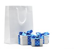 Gift bag and gift boxes. Isolated on white Stock Images