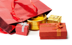 Gift bag and gift boxes isolated on white. Selective focus Stock Photography