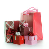 Gift bag with gift boxes. Gift boxes and shopping bag isolated on white background Royalty Free Stock Images