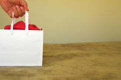 Gift bag with a hand Royalty Free Stock Image