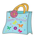 Gift bag with an inscription `Happy Birthday!`. Blue paper gift bag with handles, with a flower and an inscription `Happy Birthday Stock Photography