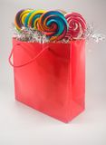 Gift bag and lollipops Stock Images
