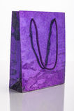 Gift bag. In purple on white Stock Photo