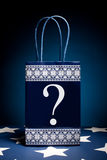 Gift bag with question Royalty Free Stock Images