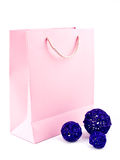 Gift bag and rattan ball on white Royalty Free Stock Photo