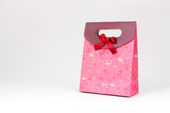 Gift bag with red bow Stock Photo