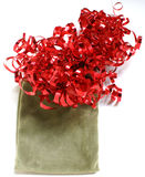 Gift bag and red ribbon. Green velvet gift bag topped with a curly red ribbon royalty free stock photography