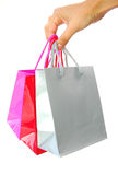Gift bags. Hand holding three gift bags Stock Photo