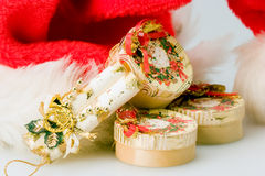 Gift bags. Small christmas gift bags in front of the Santa Claus hat Royalty Free Stock Image