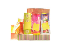 Gift bags and box with blank labels Stock Photos