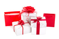 Gift bags and boxes with red ribbon on white background Royalty Free Stock Photography