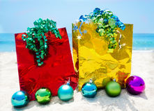Gift bags with Christmas balls - holiday concept Royalty Free Stock Images