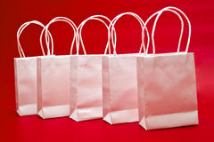 Gift Bags over Red Royalty Free Stock Photos