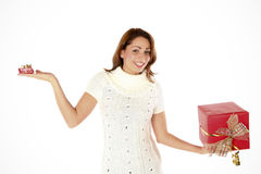 The Gift Ballance. Young Beautiful Woman Putting The Presents In Balance Royalty Free Stock Photography