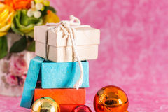Gift and balls on a background. Stock Photo