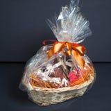 Gift basket. Against grey background Stock Photo