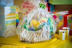 Gift basket at a baby shower with lots of colors Royalty Free Stock Photography