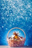 Gift basket with festive particles. Blue background royalty free stock photos