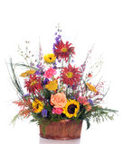 Gift Basket Flower Bouquet. An expensive gift basket filled with fresh assorted flowers, isolated against a white background Stock Image