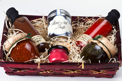 Gift basket with gourmet condiments and sauces. Stock Photography