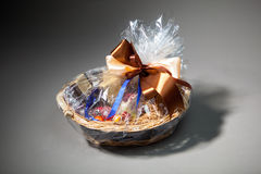 Gift basket on grey Royalty Free Stock Photography