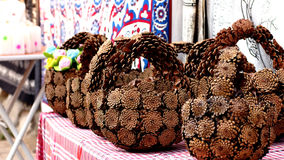 Gift basket made of pine cones Royalty Free Stock Photography