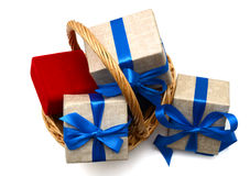 Gift with basket. Gift wrapped blue ribbon, isolated on white, Christmas and New Years Royalty Free Stock Image