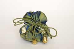 A gift in a beautiful green fabric bag Royalty Free Stock Photography