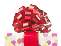 Gift with big red bow and ribbon Stock Photography