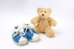 Gift for birth of boy - booties and teddy bear Stock Image