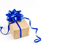 Gift with blue bow over white background. With copy space Stock Photo