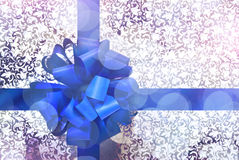 Gift with blue bow and ribbon Royalty Free Stock Image