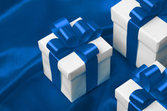 Gift on blue satin background Stock Photo