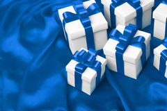 Gift on blue satin background Royalty Free Stock Photo