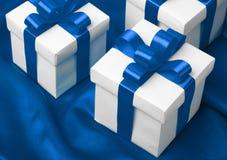 Gift on blue satin background Royalty Free Stock Image