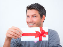 Gift bonus coupon man Royalty Free Stock Photos