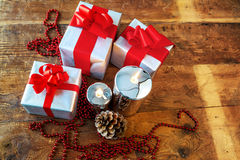 Gift boses and candles for christmas Royalty Free Stock Photos