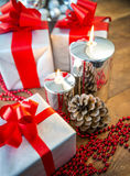 Gift boses and candles for christmas Royalty Free Stock Images