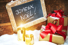 Gift boses and candles for christmas Royalty Free Stock Photography