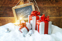 Gift boses and candles for christmas Stock Photos