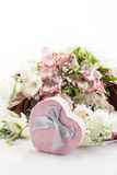Gift and bouquet of flower Royalty Free Stock Photography