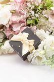 Gift on bouquet of flowers Royalty Free Stock Photography