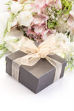 Gift on bouquet of flowers Royalty Free Stock Photos