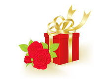 Gift and bouquet of roses Royalty Free Stock Photography