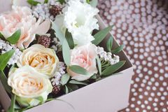 Gift bouquet of tea rose flowers. Background royalty free stock photos